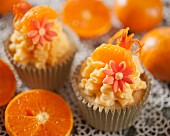 Mandarin cupcakes decorated with sugar flowers