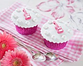 Cupcakes decorated with pink guitars