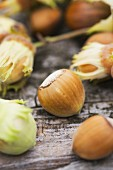 Hazelnuts on a wooden surface (close-up)