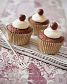 Chocolate cupcakes decorated with white chocolate buttercream