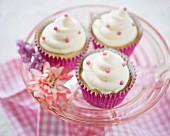 Vanilla cupcakes with pink sugar pearls