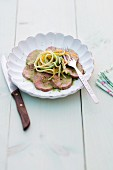 Veal fillet with vegetable linguine