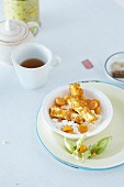 Sweet crispy tofu with cottage cheese and physalis