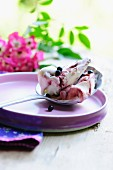 Elderberry and yoghurt ice cream on a spoon