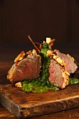 Lamb chops with a breadcrumb crust and a herb sauce