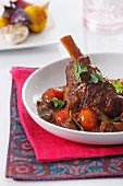 Braised leg of lamb with tomatoes and coriander