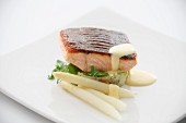 Fried salmon with white asparagus and a butter sauce