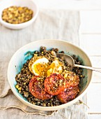 Sumac tomatoes on a bed of lentils with dukkah-coated eggs