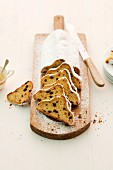 Stollen, sliced, on a chopping board
