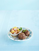 Meatballs with a radish and potato salad