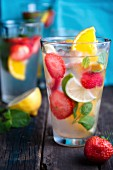 Homemade lemonade with fruits and peppermints