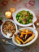 Christmas side dishes on an atmospheric Christmas table