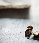 A broken hazelnut on a wooden surface