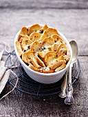 Game bolognese bake, white bread and blue cheese