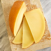 San Simon cheese (smoked Spanish cheese) on a marble chopping board