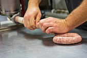 Sausages being made