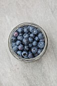Fresh blueberries in a jar (seen from above)