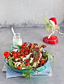 Lamb chops with grilled vegetables on a rocket salad