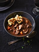 Game goulash with bread dumplings