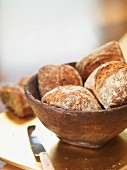 Bread rolls in a wooden bowl