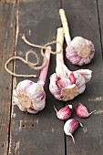 Bulbs of garlic on a rustic wooden table