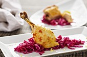 A chicken leg with red cabbage