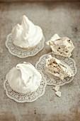 Coffee meringues on doilies