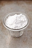 Icing sugar in a glass bowl