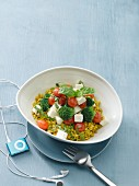 Spelt grains with tomatoes, broccoli and feta cheese