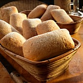 Ciabatta rolls in a wooden basket