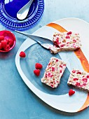 Three slices of masala fruit bread with raspberries
