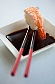 Soy sauce with a prawn nigiri sushi