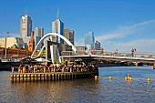 Open-air bar Ponyfish Island under the pedestrian bridge over the Yarra River, Skyline Downtown, Melbourne, Australia
