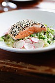 Salmon with a sesame seed crust on a cress salad with radishes