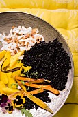 Black rice with mango and roasted coconut flakes