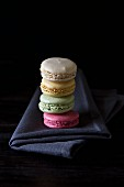 A stack of macaroons in four different colours