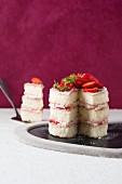 A sliced strawberry cream cake