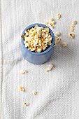 Popcorn in a blue cup
