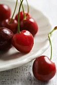 Cherries on a white plate