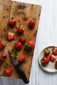 Strawberries on a rustic wooden chopping board