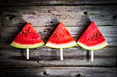 Watermelon slices on sticks