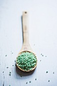 Green Japanese rice on a wooden spoon