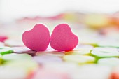 Two pink sugar hearts