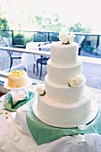 A four-tiered wedding cake on a cake buffet