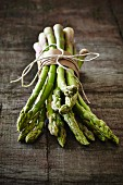 Fresh green asparagus on a wooden board