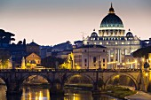 An evening view over the River Tiber of St Peter's Cathedral, Vatican, Rome