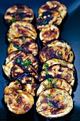 Grilled aubergine slices with chilli and mint