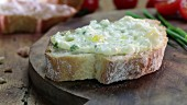 Egg salad spread on a slice of baguette