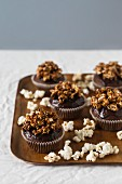 Chocolate cupcakes with caramelised popcorn