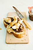 A slice of sweet yeast bread topped with chocolate cream and pears